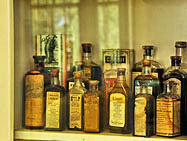 Square House Medicine Bottle Display